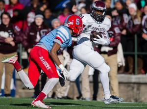 <p>LaDarius Dickens, seen here playing against Skyline, had three touchdown catches on Saturday in the Eagles' 31-24 overtime loss to Atascocita.</p>