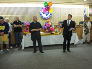 <p>McKinney ISD Superintendent Rick McDaniel, right, says a few words at a reception Thursday to honor Harvey Oaxaca, left, who's retiring after 22 years with the school district.</p>