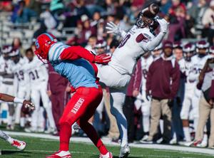 <p>Rowlett's LaDarius Dickens tries to make a juggling catch in the Eagles' 24-21 victory over Skyline on Saturday at Mesquite Memorial Stadium.</p>