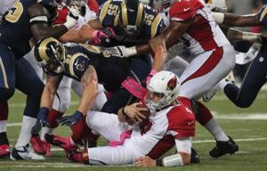 The Rams defense gave Kevin Kolb fits all night long