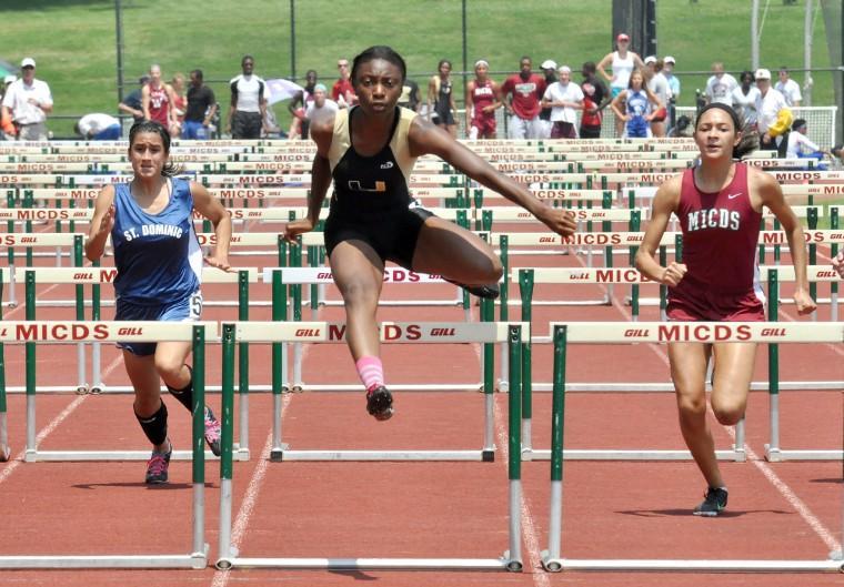 U-City's Kayla Heidelberg hurdles the competition