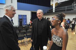 SLU Interim President William Kauffman, Father Paul Stark and Morgan Moody