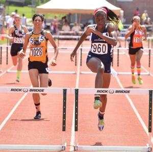 <p>McCluer North standout girls hurdler Jasmine Barge (right) is the St. Louis American Girls Track and Field Athlete of the Year after leading the Stars to their second consecutive state championship.</p>