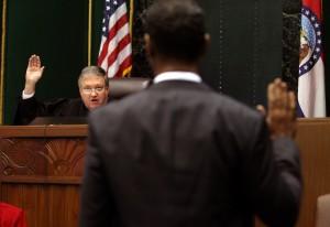 Judge Michael Manners swears in Reggie Clemons