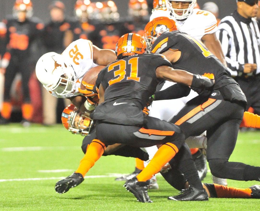 Texas dominates struggling Oklahoma State Sports