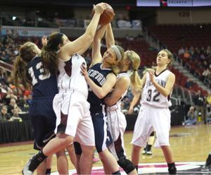 <p>(Above) Kennedy Madsen fi ghts for control of the ball in Monday's state tournament game against Bedford. Though Exira-EHK is the third-highest scoring team in 1A, the Spartans get half or more of their points from a tough defense.</p>