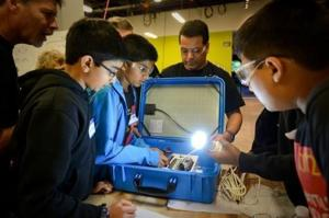 OAHS students learn STEM, assemble suitcases for Kenyan delivery