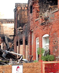The fire that destroyed two businesses, and severely damaged others has been labeled as arson.