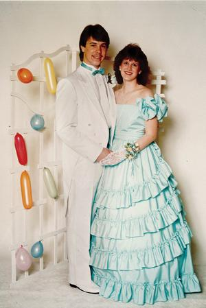 """Kathy Wilkinson, principal office secretary at Lake Fenton High School, went to prom at Lake Fenton with her date, Todd Wilkinson. """"I went with him to his senior prom in 1984 and he went to my junior prom in 1985 and senior prom in 1986,"""" said Wilkinson."""