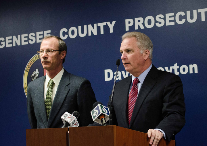 Genesee County Prosecutor David Leyton (right) announces charges against Zachary Lee Parker, 18, of Swartz Creek.