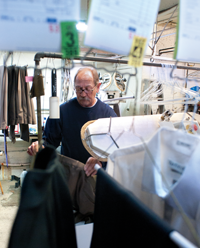 Dixie Cleaners co-owner Tom Moleski irons pants at the shop on Wednesday in Fenton. His business has been in the family for 60 years.