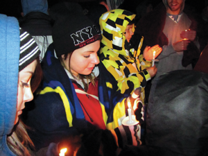 Randi Harper, 17, holds a candle in prayer for Jesse Hourigan. Harper says that Jesse's struggle has made her realize the importance of living each day to the fullest.