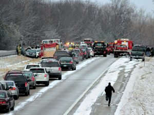 A man runs toward the 30-vehicle crash on U.S. 23 Saturday.