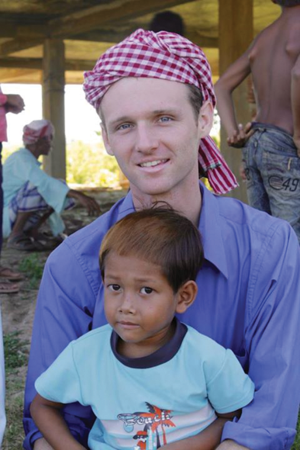 Joshua Hooker with a young boy at Phreah Vihear in this 2012 photo.