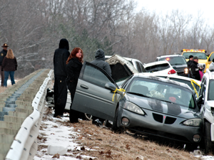 Victims of the 30-car crash on Saturday including Charleen Kowal-Taylor (center) wait while emergency crews work through the collisions that began at around 1 p.m. on Saturday.
