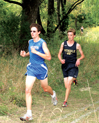 Lake Fenton's Caleb Fletcher (left) edged out Bendle's Tim Kimble for first place during Tuesday's race at Lake Fenton High School.