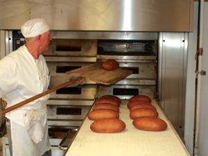 Sourdough, dark rye and cinnamon raisin are only a few of the types of breads Crust bakers make daily in the downtown Fenton bakery.