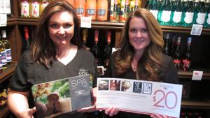 <p>Serendipity co-manager/massage therapist Jamie Sweet (left) and owner Jessica Skop hold up spa certificates for the upcoming Black Friday promotion on Nov. 27.</p>