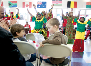 Tomek-Eastern Elementary School students watch a performance by Kevin Collins' Kuungana percussion and dance group, during the IB World Fair in 2012.