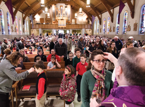 More parishioners than usual attend the 2014 Ash Wednesday service at St. John Catholic Church.