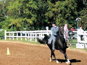 Fenton's Nadine Lessard competes in an equestrain event. Lessard will compete  at the state meet this weekend.