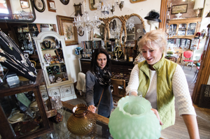 On Wednesday, Stacy Mielcarek (right) and customer Domini Zatroch try different shades on an antique lamp.