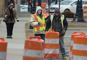 Theresa Frederick and Brett Davis of Champagne & Marx survey the construction area on Thursday.