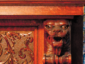 The carved heads of a lion flanks one of seven functioning fireplaces inside the home.