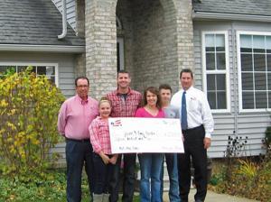 """<p>New homeowner Jason Rowden earned rebates and discounts in his recent transactions with Realtor Brian Will (left) and Jim Shadduck (right) through """"Homes for Heroes.""""</p>"""