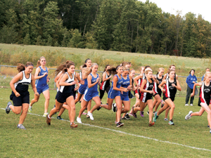 Lake Fenton's runners try to work themselves through the pack at the start of the race on Tuesday. Lake Fenton's girls defeated New Lothrop at the meet.