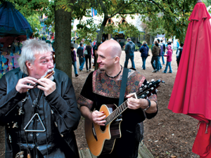 Wally Jarvis (left) and Ernesto Villareal perform near the entry of the Renaissance Festival last week. They also have regularly scheduled shows as a full band. This is the last weekend for the Ren-Fest this year.