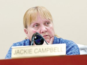 Holly Village Council Member Jackie Campbell listens to a public comment concerning historical properties in the village at the last meeting.