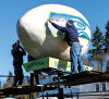 Super Egg Artist decorates Winlock's giant egg to show support