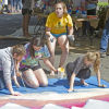 Students get creative painting Happy Kids Dental's parking lot in Longview