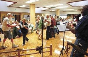 Senior Center celebrates new kitchen, refinished dance floor