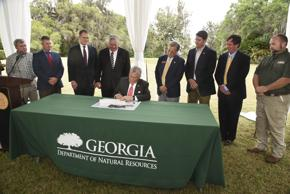 <p>Gov. Nathan Deal signed the 2017 fiscal year budget Monday at Altama Plantation, a nearly 4,000 acre property in northern Glynn County. The plantation was once a hunting retreat and was acquired by the Georgia Department of Natural Resources last year. Deal noted in the budget signing ceremony that protecting the state's natural habitats is a key priority for this new budget, which goes into effect July 1.</p>