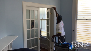 Volunteers help paint the CASA Glynn visitation center for United Way