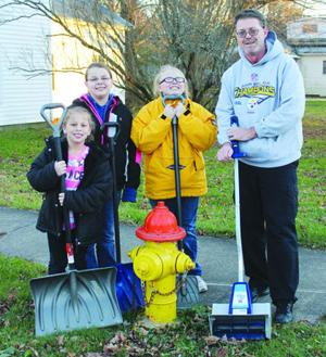 <p>Hannah, Danielle, Cassie and Homer Williams have unofficially adopted a fire hydrant on the southeast corner of West Smith and Marion streets. They've pledged to keep the hydrant clear of snow for the duration of winter and hope their act of service will inspire others to adopt their local hydrants.</p>