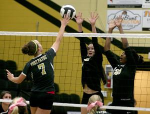 <p>Scottsboro's MegGarner (8) and Telisha Snodgrass go for a block on FortPayne's Kandi Duncan during the teams' Class 6A Area 13 Tournament semifinal match on Tuesday.</p>
