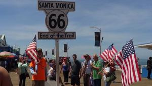 <p>Pastor Walter McGill, left, celebrates with passersby upon reaching the Santa Monica Pier in California to end his cross-country walk. McGill's walk spanned 3,242 miles across 14 states and took just more than a year to complete.</p>