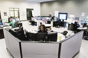 Dispatcher JaNett Brabson takes calls at the Blount County E-911 Communications Center.