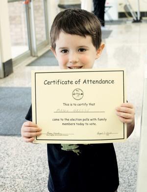 Mason Greene with voting certificate