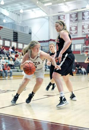 <p>Alcoa's Riley Hicks (3) dribbles out of trouble after collecting a defensive rebound. Maryville's Lindsey Taylor (44) tries to cut off the Hicks' path.</p>