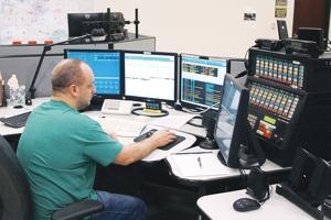 Dispatcher David Nelson uses new dispatch system