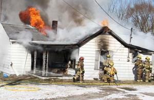 AT&T representative, neighbor, passerby force Maryville man to leave burning residence