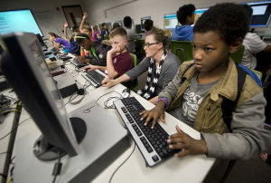 Kids learning computer code in after-school clubs