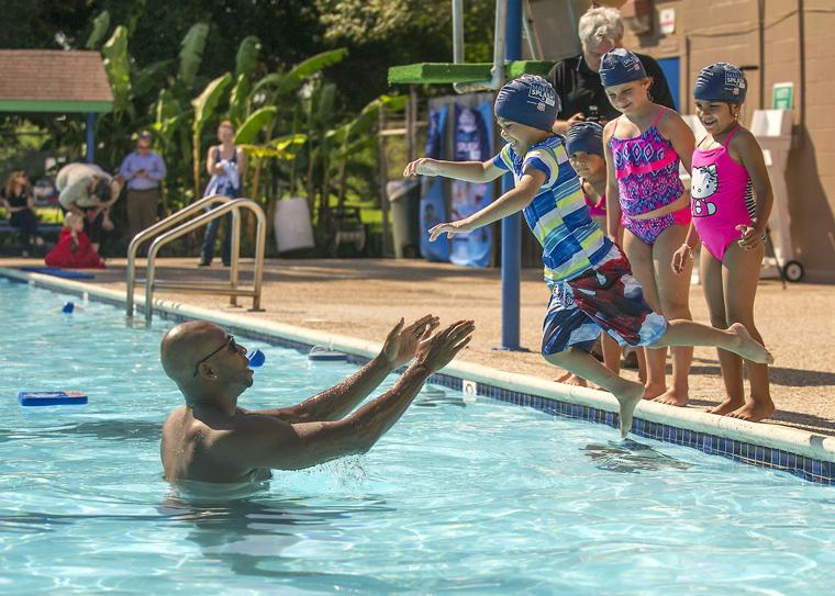 Olympian instructs youngsters in water