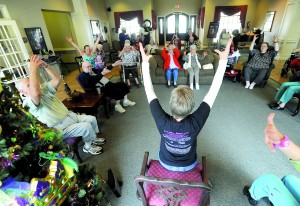 Mature moves chair zumba gets seniors moving the for Chair zumba
