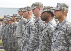 <p>Members of the 442nd Engineer Company stand in formation during the National Guard sendoff ceremony Friday at Wildcat Stadium in Angleton. The troops will be heading to Fort Bliss in El Paso to complete their company training before deploying to Afghanistan as a support unit.</p>