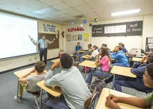 <p>Esequiel Quiralte gives his class a thumbs up after a student answers his question correctly during class Wednesday at Sweeny Junior High School.</p>